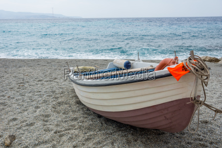 fishing boat on a deserted beach