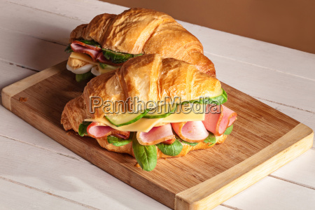 croissants sandwiches on the wooden cutting