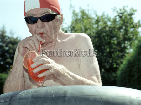 senior man drinking juice