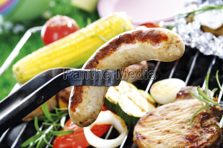 meat sausage and vegetables on grill