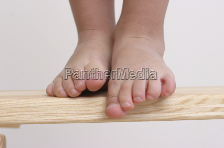 feet of a child taking a