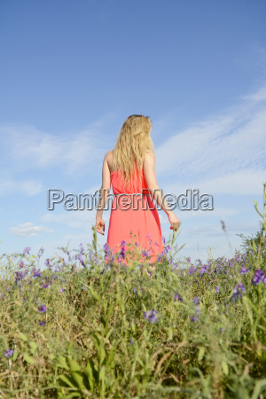 young woman on flower meadow