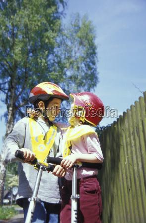children wearing crash helmet smiling