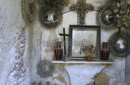 picture frame and cross on wall
