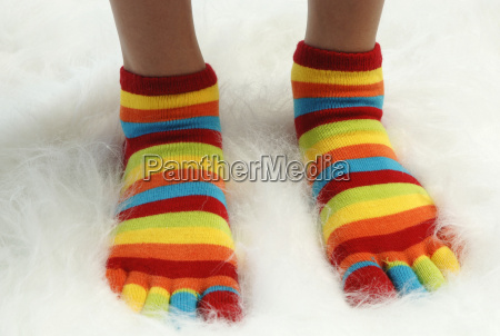 person wearing striped socks elevated view