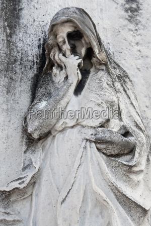 italy venice graveyard statue close up