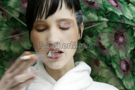 young woman smoking portrait