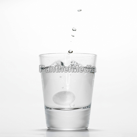 glas of water with fizzy tablet