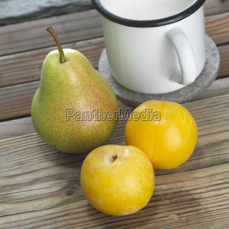 pear yellow plums and mug of