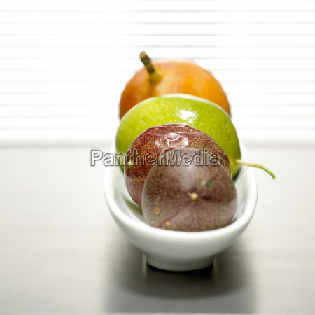 passion fruits and grenadilla in bowl