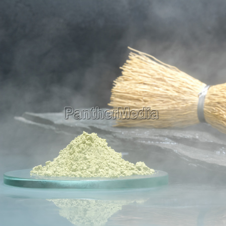 matcha tea powder with tea brush