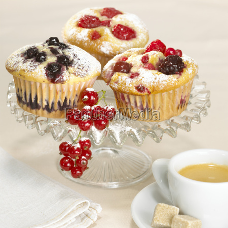fruit muffins on glass bowl close
