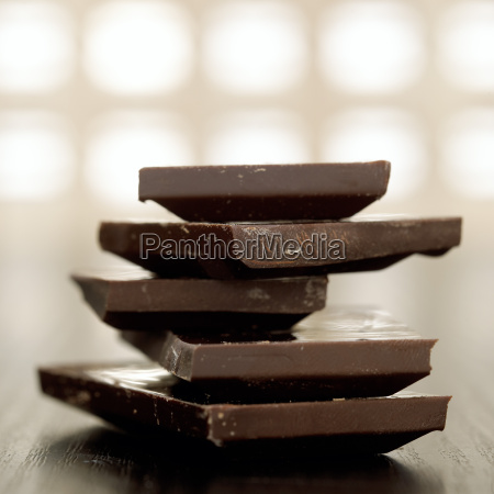 dark chocolate pieces stacked close up