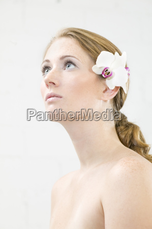 young woman with flower in hair