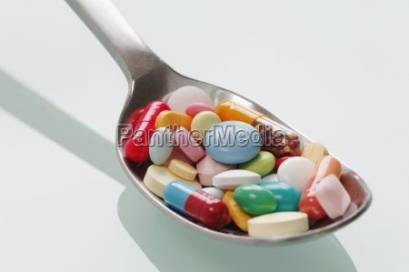 spoon full of pills close up