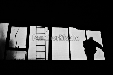 man standing on window rear view