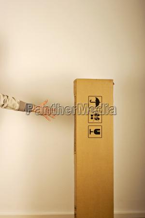 man pointing carton