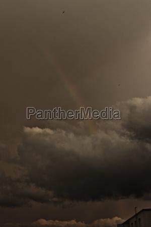 germany pforzheim rainbow against grey clouds