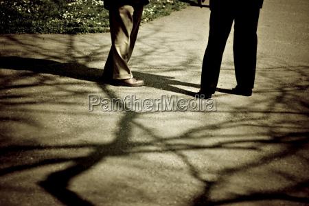 two men standing in park low