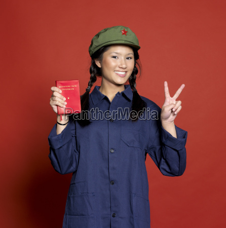 young woman standing with book and