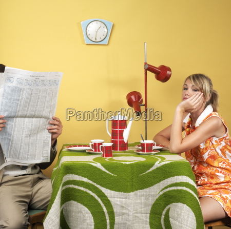 young couple having coffee side view