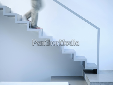 man moving down stairs side view