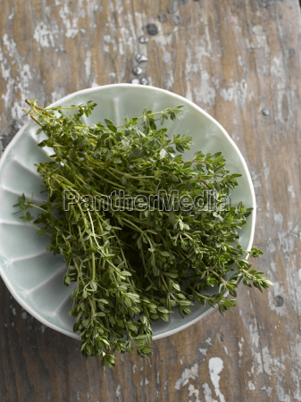fresh thyme in bowl elevated view
