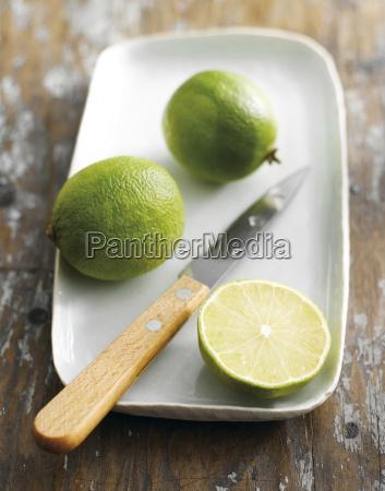 sliced lime on platter close up