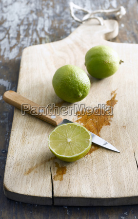 sliced lime on chopping board elevated