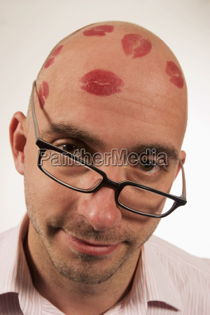 man with lipstick kisses on head