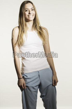 young woman in sportswear against white