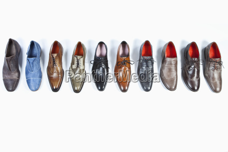 row of shoes on white background