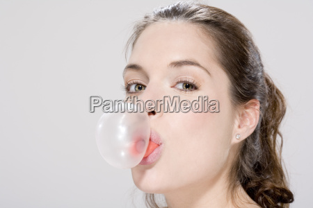 young woman blowing bubble gum portrait