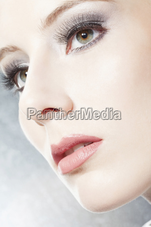 young woman looking away close up