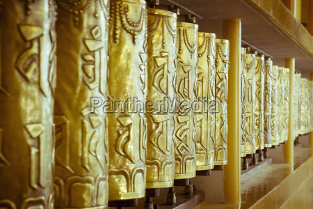 india dharamsala row of prayer wheels