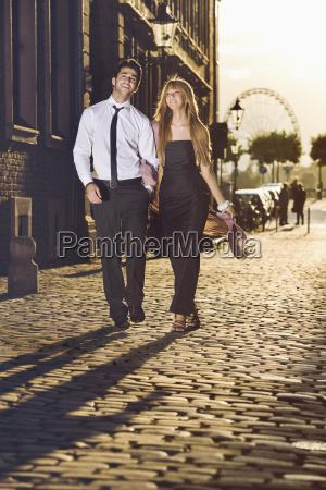 germany duesseldorf couple walking arm in