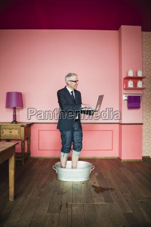 germany stuttgart businessman standing in bathtub
