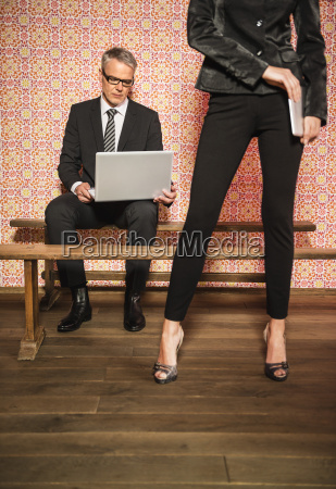 germany stuttgart business couple using laptop
