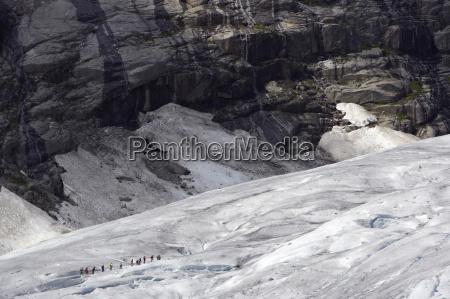 norway nigardsbreen tourists walking across glacier