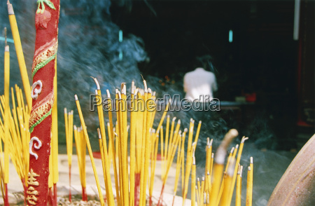 vietnam saigon burning incense sticks