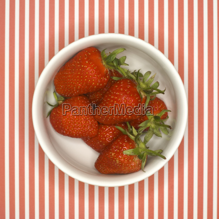 fresh strawberries in bowl elevated view