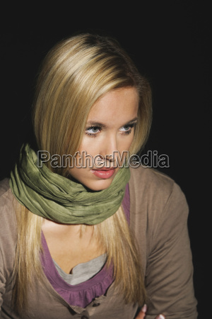 young woman wearing scarf portrait
