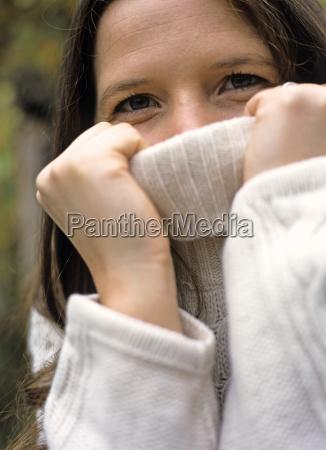 woman wearing sweater close up