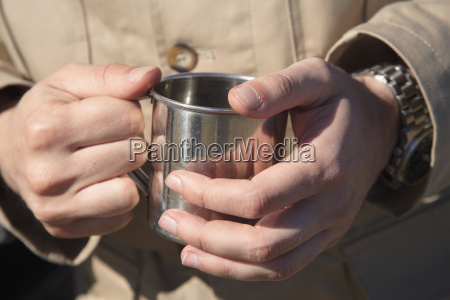 africa botswana man holding mug close