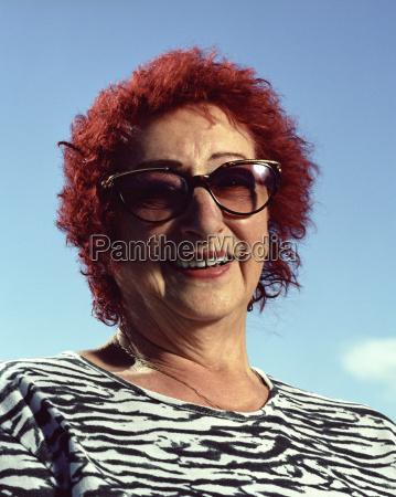 elder woman wearing sunglasses smiling portrait