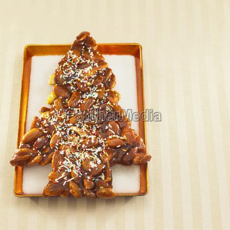 christmas tree shaped almond cookie on