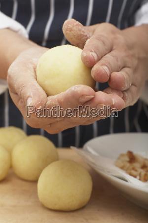 shaping a potato dumpling close up