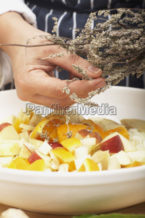 person flavouring the stuffing with mugwort