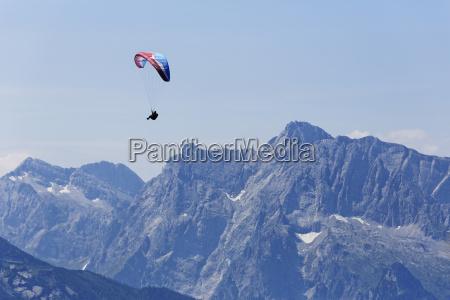 germany bavaria paraglider flying over berchtesgaden