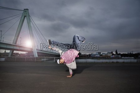 germany cologne young man performing breakdance